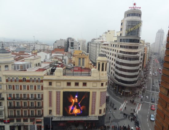The Gran Vía as seen from the Corte Inglés in Callao, with the Capitol building (A on the map). The façade on the left defines the western Callao limit