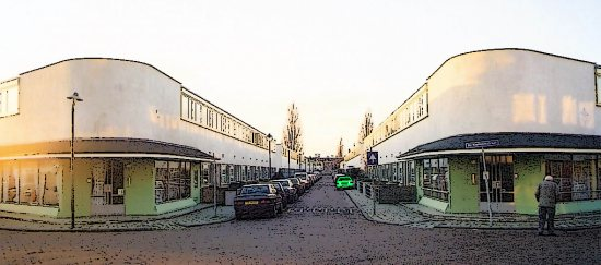 The entrance to the neighborhood, with the two shops