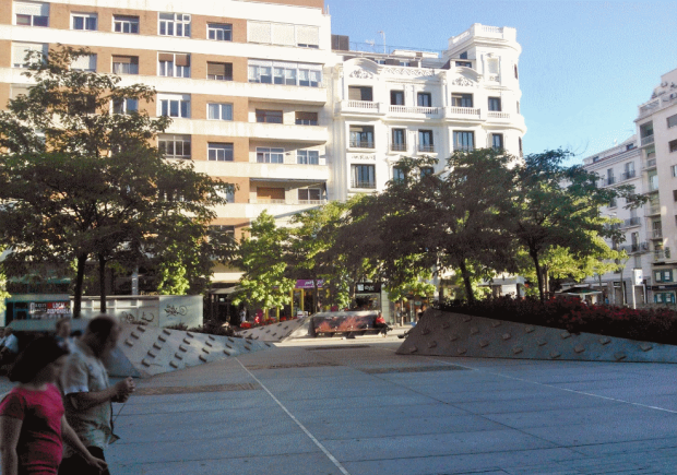 "The trees on the western part of the square. The ""plugs"" on the sloped granite are a ""solution"" against damage by skaters."