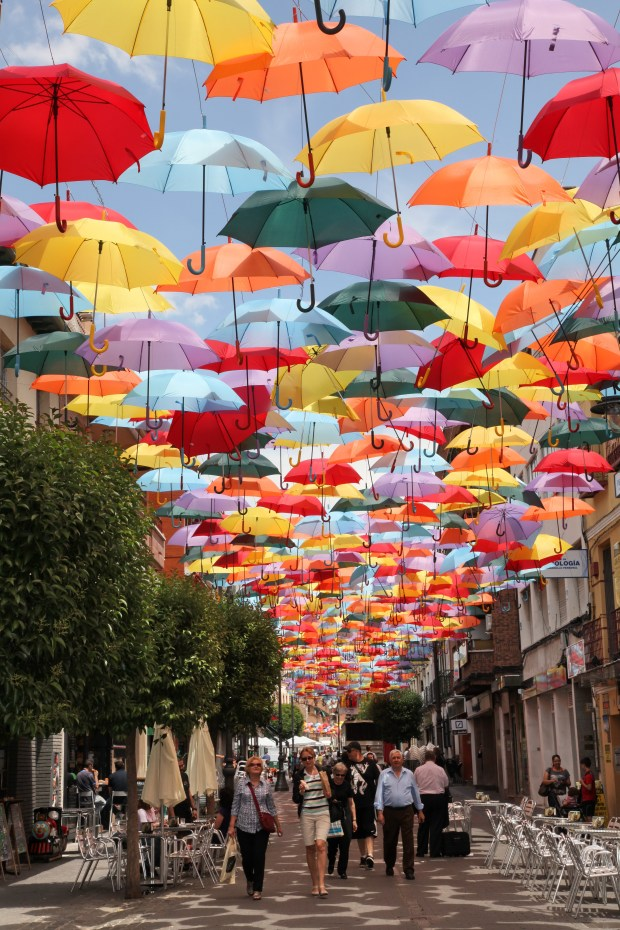 The Getafe Umbrellas, as seen on the municipal website http://getafe.es/la-calle-madrid-se-cubre-de-paraguas-de-colores-para-potenciar-el-comercio-de-la-zona-centro/
